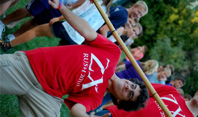 Sophomore Michael Preut clears the limbo bar Monday at the annual Baker University Greek Life Block Party. Preut and other members of the greek community joined together for the block party in Mabee field.