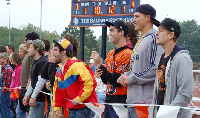 Students cheer on the Baker University football team in its game against Central Methodist University. The Wildcats defeated CMU 31-7.