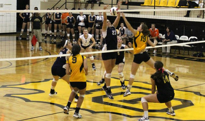 Senior Sydney Pemberton jumps up for a block in the Wildcats' sweep of Ottawa University Tuesday in Ottawa.
