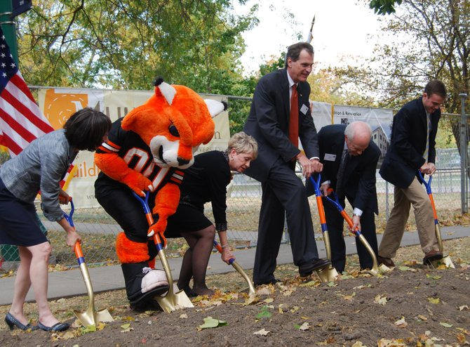 Professor Biology Darcy Russell, WOWzer, University President Pat Long, Chair of the Baker University Board of Trustees Hoot Gibson, BOT member Rich Howell and Baker University Student Senate President Caleb Watts turn over dirt outside Mulvane Hall as part of the groundbreaking ceremony.