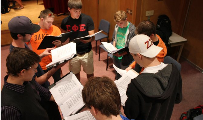 Men in the bass section of the Baker University Concert Choir practice speaking in rhythm before the choir sings together to prepare for the fall concert. Director of Choral Activities Matthew Potterton said the male section of the choir is strong this year. The fall concert is at 7:30 p.m. Oct. 28 at Baldwin First United Methodist Church.