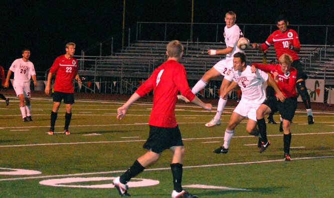 Junior Rich Klein fights off a Benedictine College defender in Saturday's 3-0 win over the Ravens at Liston Stadium. The victory moved the Wildcats to 15-0 overall and 5-0 in the Heart of America Athletic Conference.