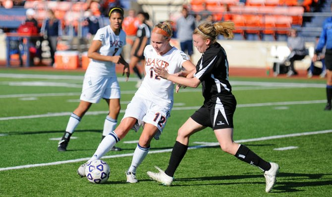 Senior Ashley Ukena dribbles the ball early in the first half against Bellevue University Saturday at Liston Stadium.