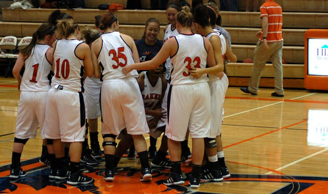 Senior Gloria Atanmo celebrates with the rest of the Baker women's basketball team shortly after the game.