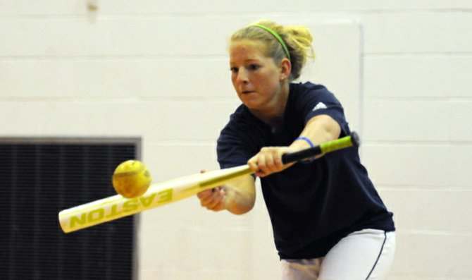 Junior Tara Heinrich lays down a bunt in practice Wednesday. The Wildcats are 1-1 on the season after splitting their first doubleheader with Ottawa University. BU will play in the Cowtown Classic Saturday and Sunday in Fort Worth, Texas.