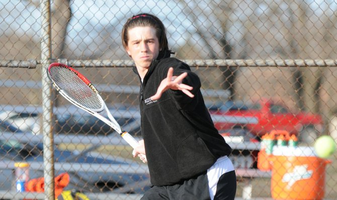 Freshman Ryan Baker returns a volley in practice Wednesday at the Laury Tennis Courts. BU will return to action against Graceland University Saturday.
