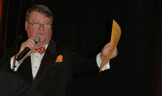 Jerry Weakley, vice president for endowment and planned giving, auctions off items at the Baker University Scholarship Gala and Auction Saturday at the Sheraton Overland Park Hotel.