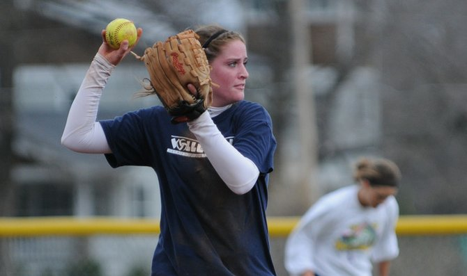 Sophomore Cami Williams throws the ball to first base during practice.