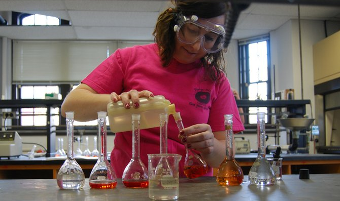 Sophomore Sierra Wallace works on finishing an experiment during lab in Mulvane Science Hall before spring break. Science students using labs this semester have a strict deadline to complete lab work before spring break because of the Mulvane renovation. The labs will reopen when construction on the building is complete.