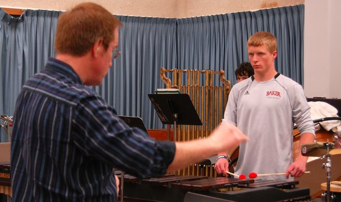 Instructor of Music Steve Riley directs freshman Greg Henning and other members of the Baker University percussion ensemble Thursday morning during class. The percussion ensemble is made up of seven members, including seniors Brittany Hines and Scott Ireland, who will conduct the ensemble during its final performance of the year.