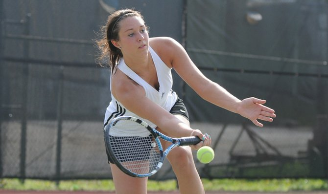 Freshman Avery Vogts eyes the ball in practice at Laury Tennis Courts. The Baker mens and womens tennis teams will host their annual matches Saturday at Laury Tennis Courts.