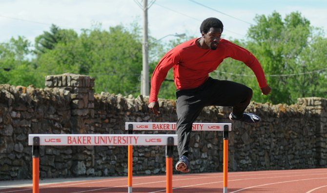 Senior J.L. Anderson practices hurdling during practice. 