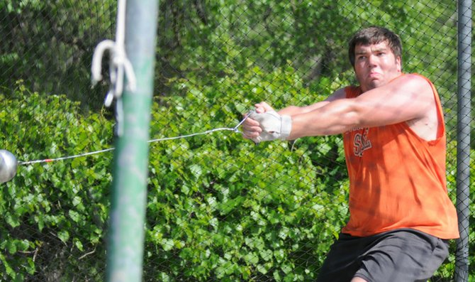 Freshman Sheldon Jacks throws the hammer in practice Wednesday at Liston Stadium. Jacks and the rest of the Baker University track and field team will compete in the Wildcat Open Saturday at Liston Stadium.
