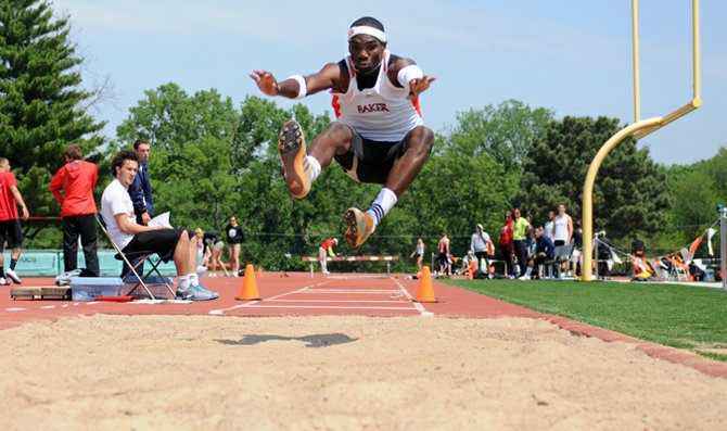 Junior Jeremy Gathright competes in the long jump Saturday in the Wildcat Open at Liston Stadium. Gathright won the long jump and also broke an 87-year-old school record in the 400-meter dash.
