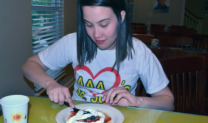 Junior Courtney Chambers eats pancakes at Delta Delta Delta sorority's annual Delta House of Pancakes fundraiser. The group raised $375 for St. Jude Children's Research Hospital, the sorority's philanthropic cause.