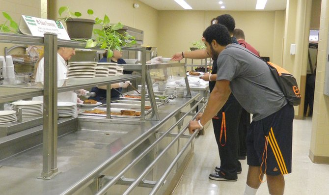 Students go through the lunch line in Allen Dining Hall. The current cafeteria setup is set to change with Baker University's dinning services transition to Sodexo.