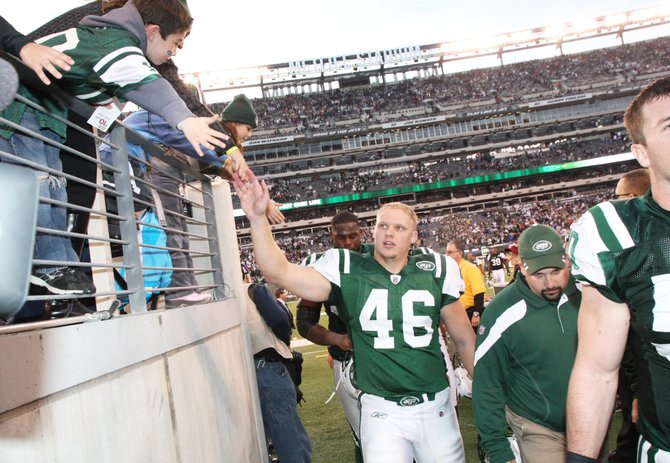 New York Jets long snapper Tanner Purdum greets fans after a game at MetLife Stadium. Purdum signed a two-year contract extension with the Jets on March 18. He spent his college career as the long snapper for the Baker University football team.