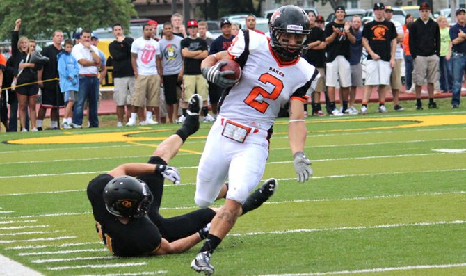 Kyle Bolton runs past a defender in the Baker University football team's 27-20 win against Ottawa University Aug. 25 at Peoples Bank Field. Bolton attended the NFL Super Regional Combine Sunday and Monday at Cowboys Stadium in Dallas.