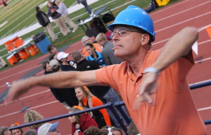 Minister to the University Ira DeSpain directs the Baker pep band during a football game in 2011. University President Pat Long announced DeSpain's retirement effective June 2014 in a campus-wide email Tuesday.