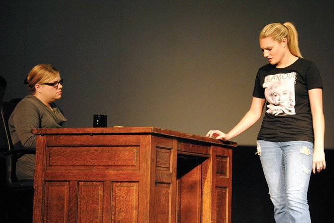 "Baker alumna Kelly Braud, who plays the role of a doctor/mother, talks with sophomore Katie Masters during the Baker University production of ""New York."" The play opens at 7:30 p.m. on Sept. 11."