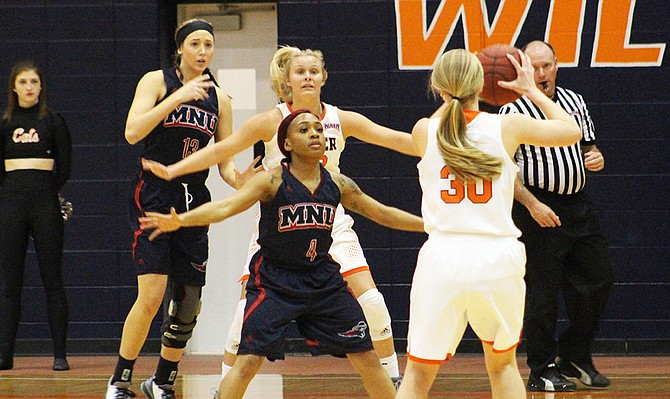 MidAmerica Nazarene tries to defend sophomore Anna Hignight and the Baker offense in the Heart of America Athletic Conference Tournament semifinals on March 3. The Wildcats defeated MNU to move onto the finals.